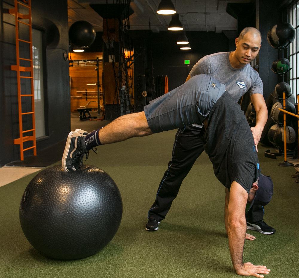 DIAKADI Trainer Derrick Lee swissball core work.jpg