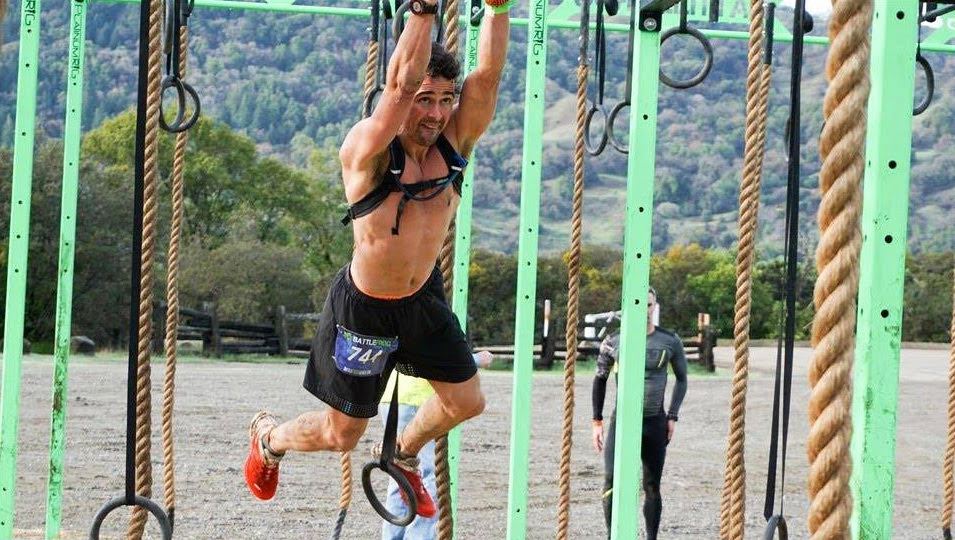 Diakadi Trainer Elijah Markstrom olympic lift.jpg