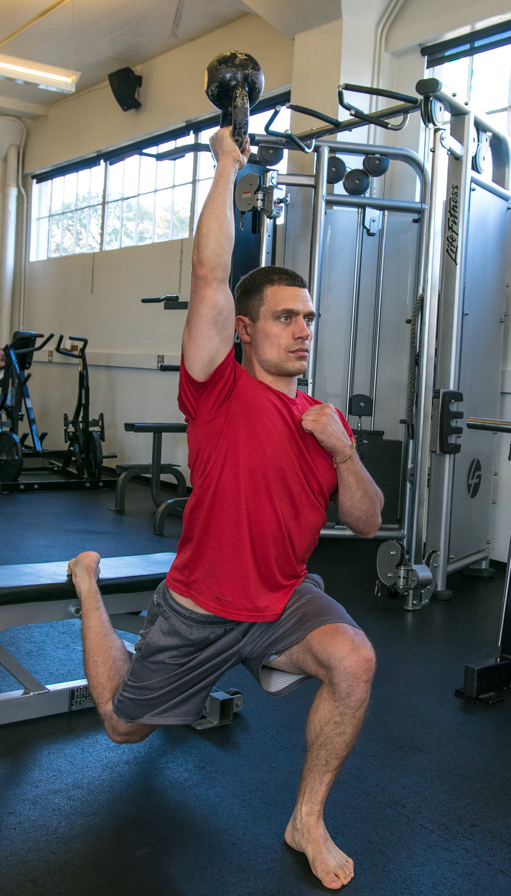 Tycho Bergquist bulgarian split squat overhead kettlebell hold institute of motion.jpg