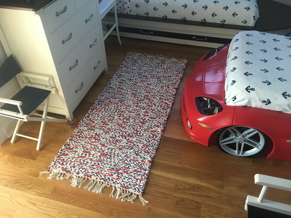 Boys bedroom. Note the car and boat beds!