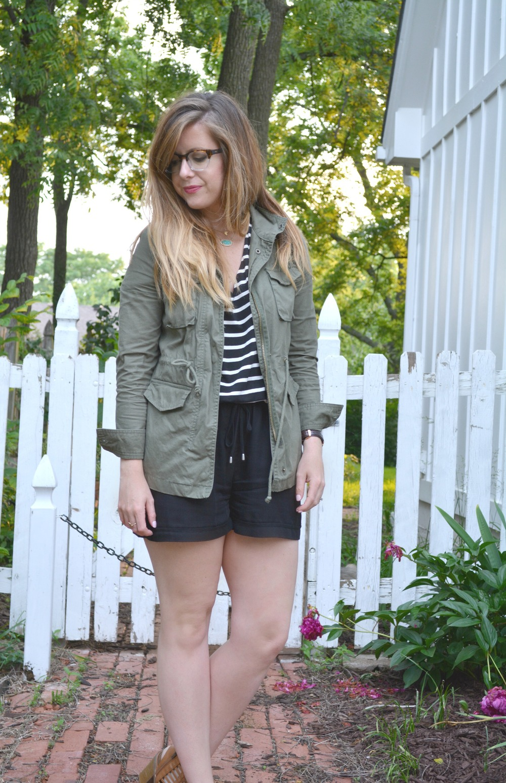 Polette eyewear, green cargo jacket, and stripe Anthropologie romper on Sophisticaited.com