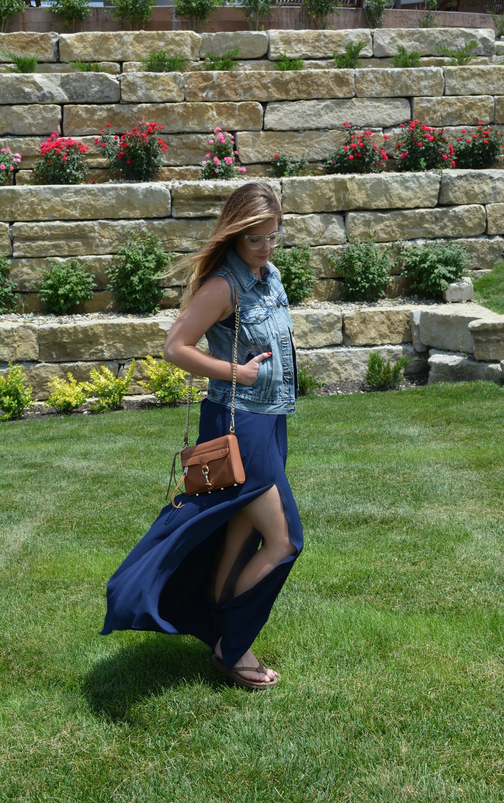 Denim vest with maxi dress on Sophisticaited.com