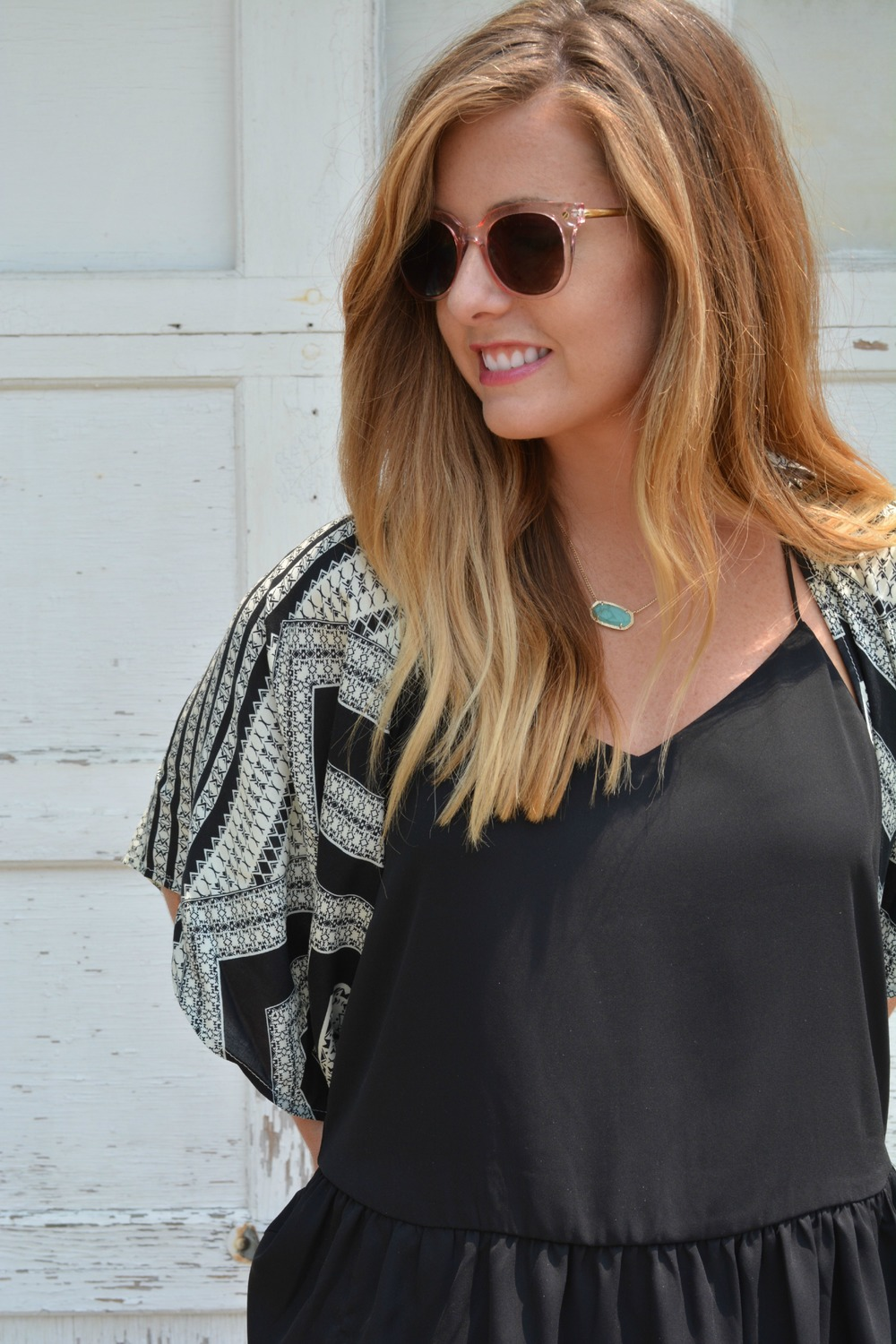 Black tank top with printed kimono and pink sunglasses on Sophisticaited.com