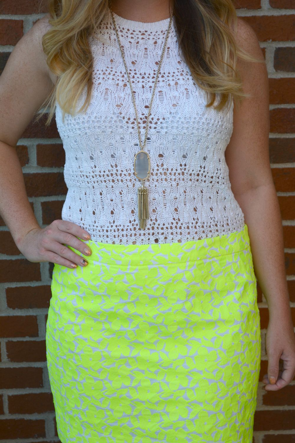 White tank with bright skirt and Rayne necklace on Sophisticaited.com