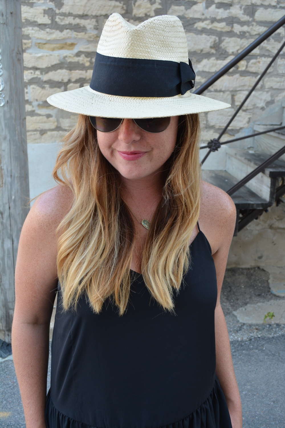 Panama hat with black tank on Sophisticaited.com