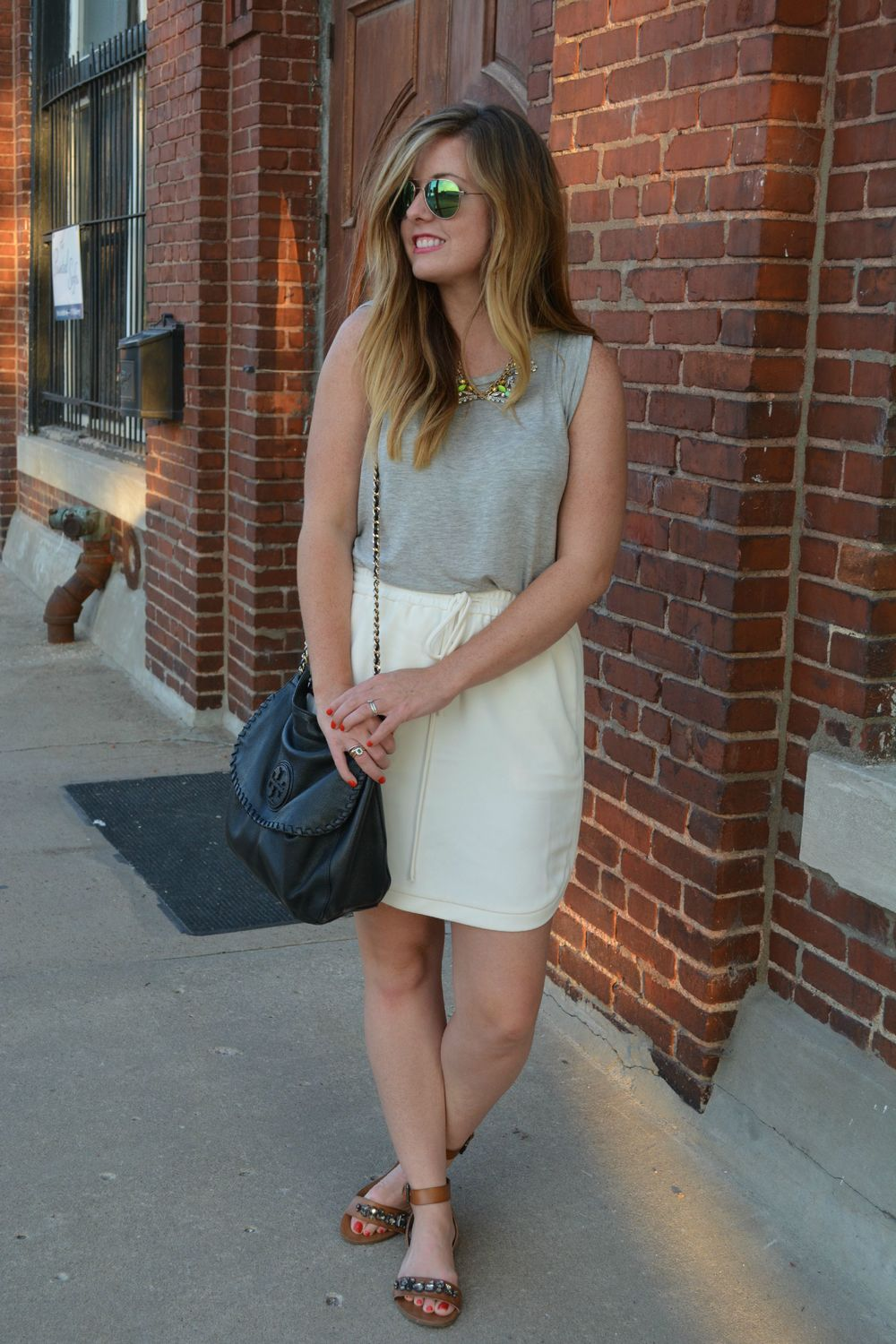 Gray tank with ivory skirt with tan sandals on Sophisticaited.com