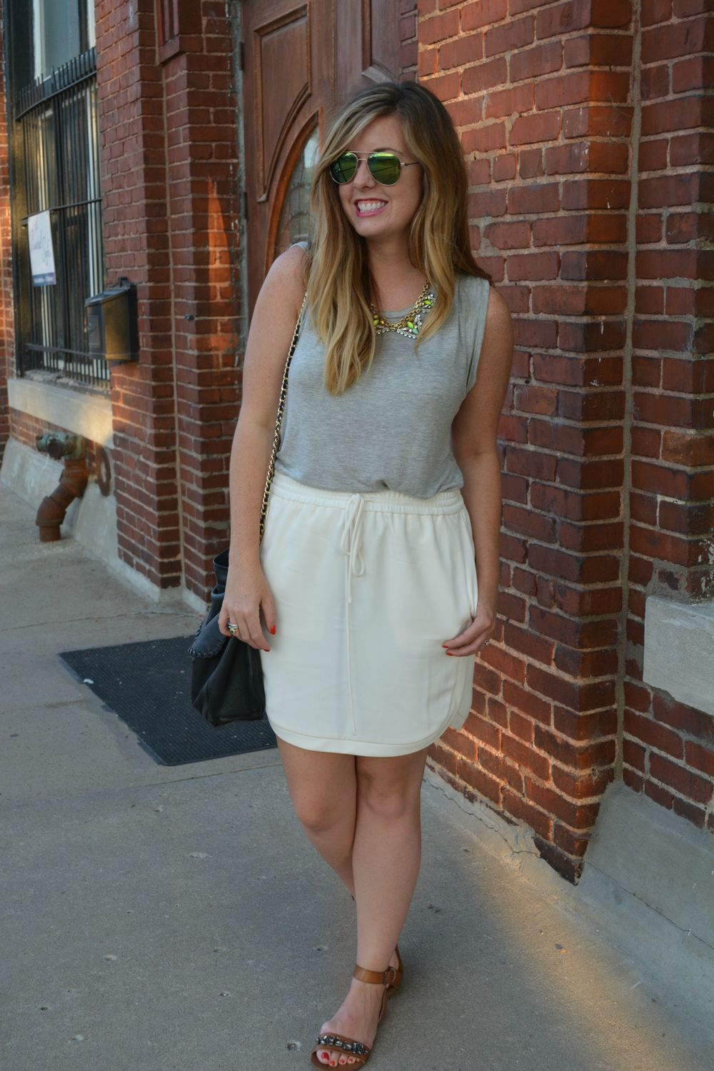 Gray tank with ivory skirt and tan sandals on Sophisticaited.com