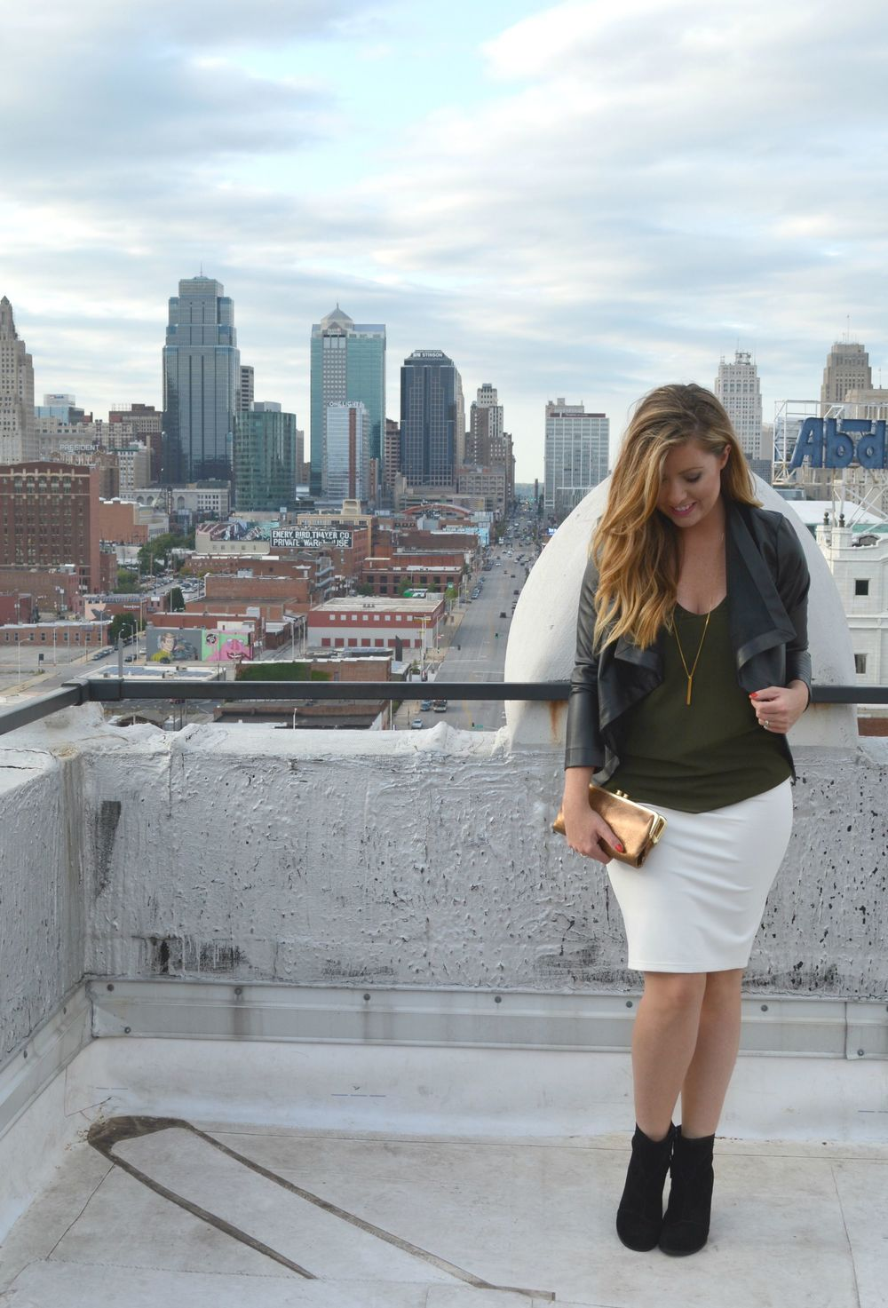 Black blazer olive green tank ivory skirt with black booties on Sophisticaited.com