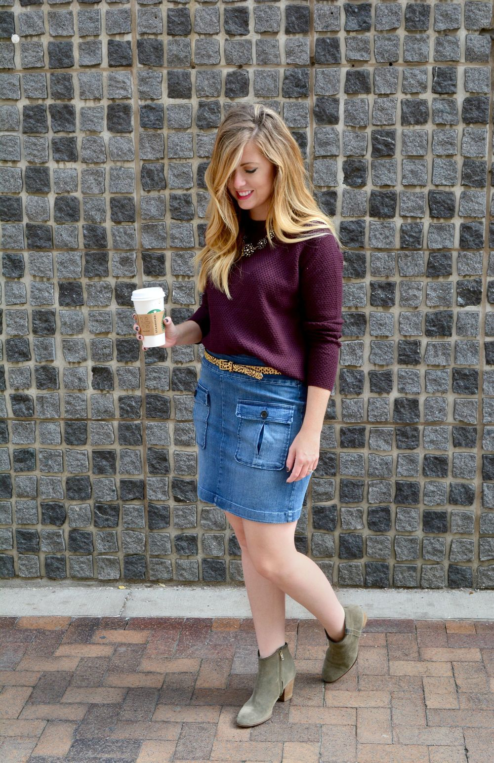 Maroon sweater denim skirt leopard belt and booties on Sophisticaited.com