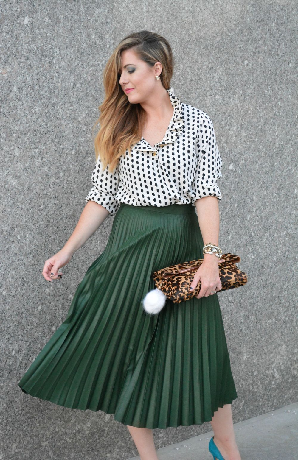 Black and white polka dot top with Zara green pleated midi skirt on Sophisticaited.com