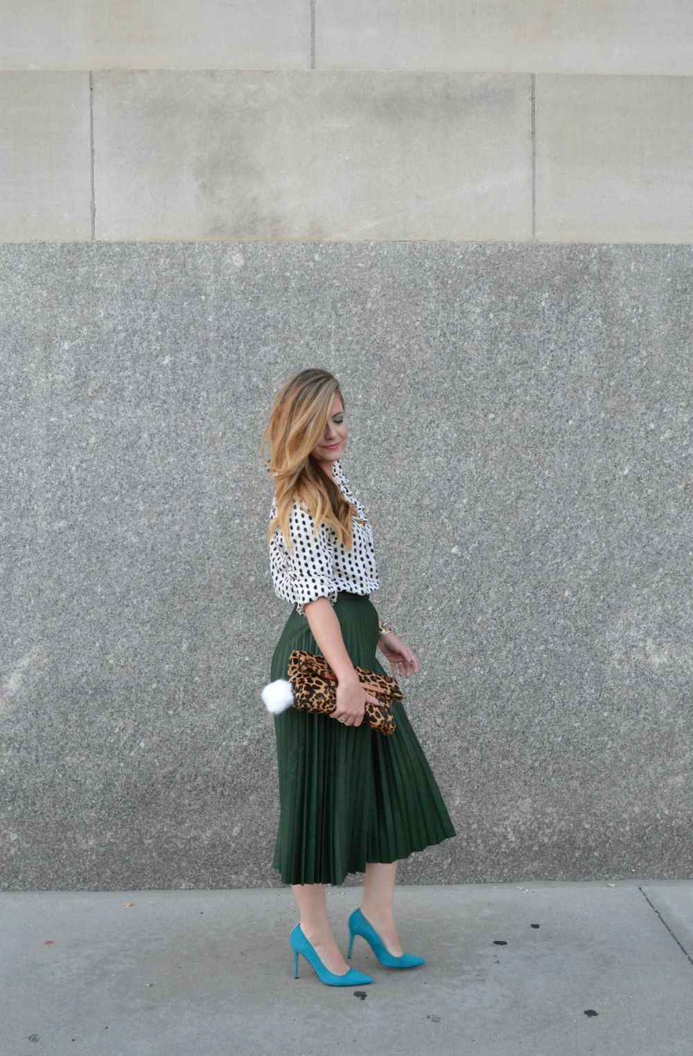 Black and white polka dot top with Zara green pleated midi skirt on Sophisticaited.com