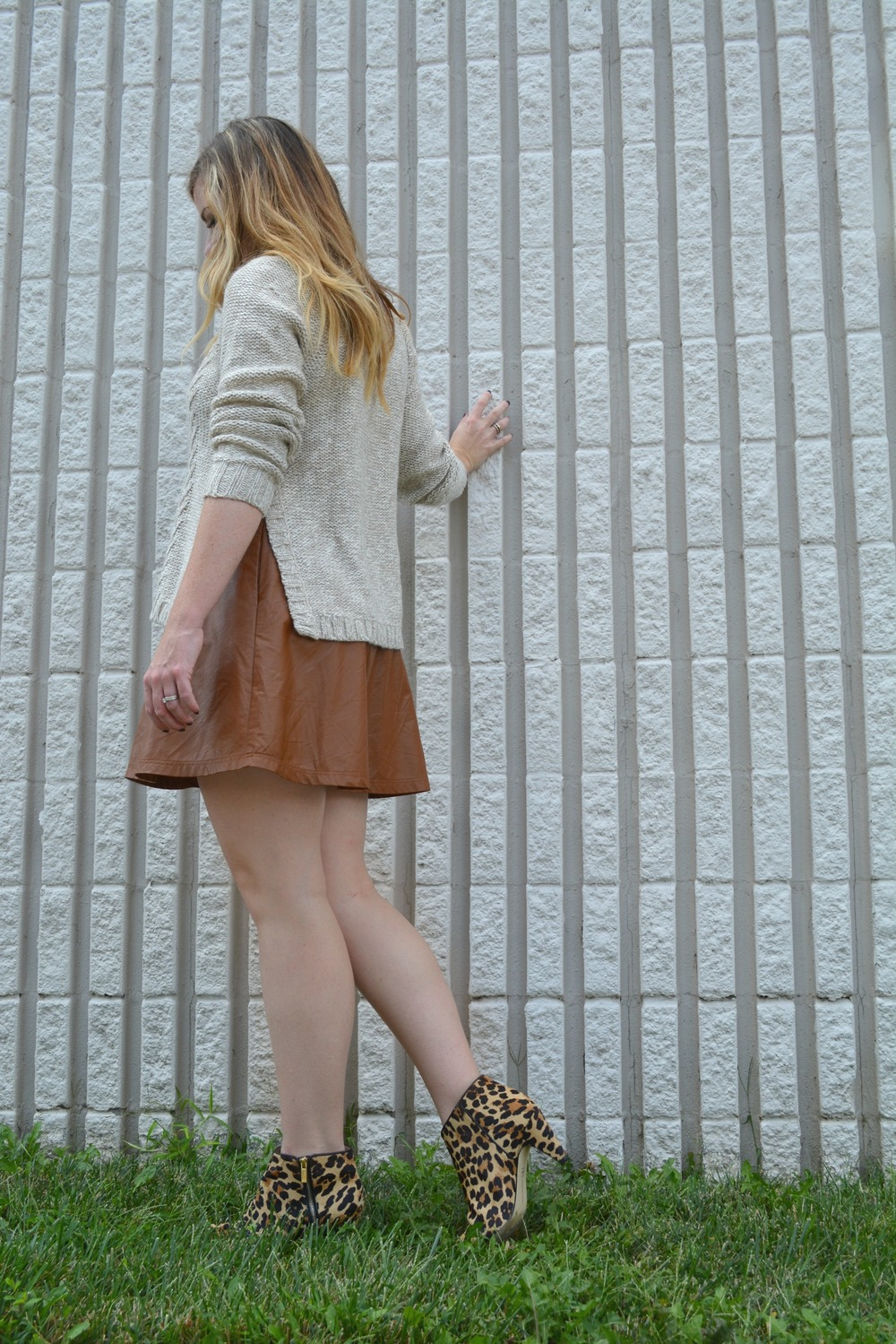 Creame sweater with tan leather skirt and leopard booties on Sophisticaited.com