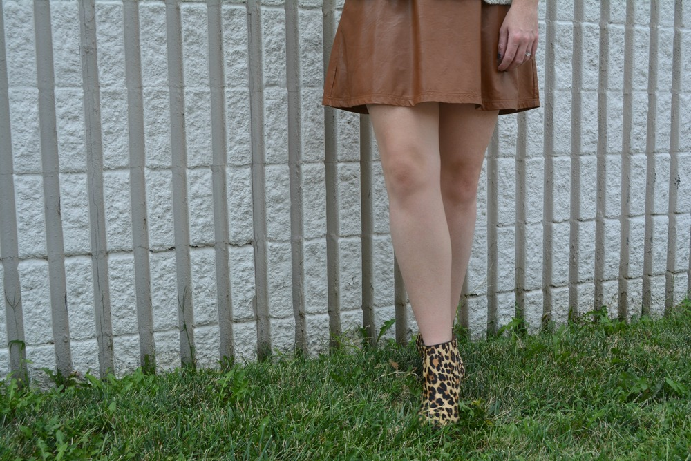 Tan leather skirt fall outfit on Sophisticaited