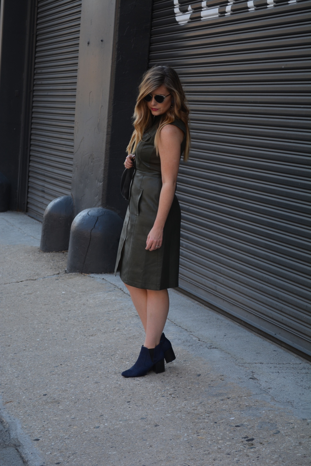 Leather BCBG dress and navy booties on Sophisticaited