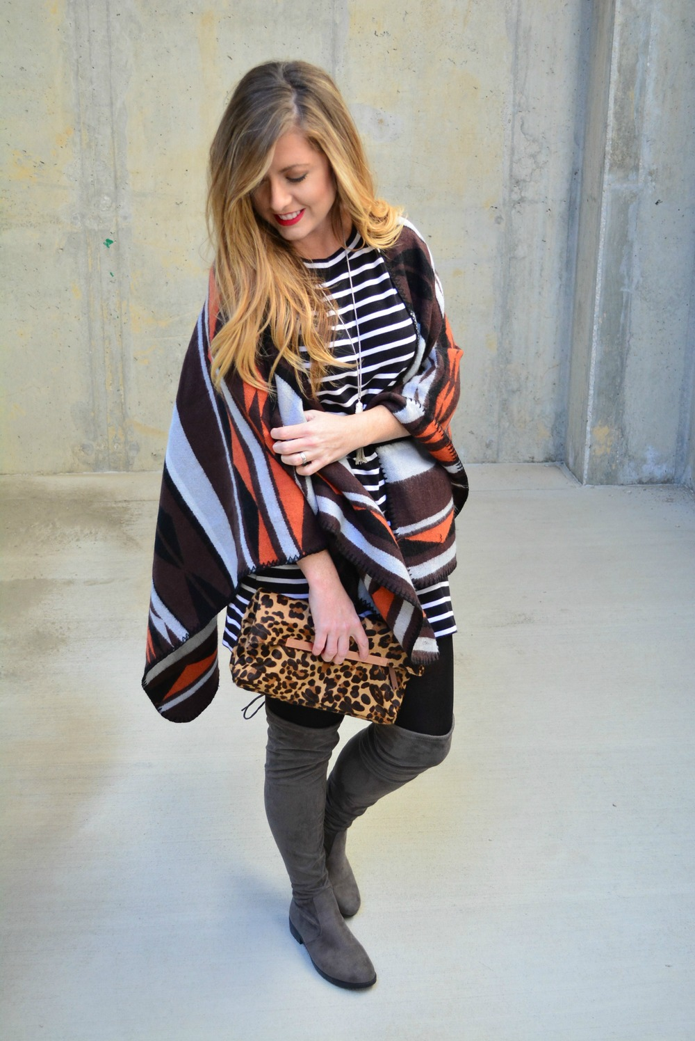 Stripe dress, poncho, and over the knee boots outfit