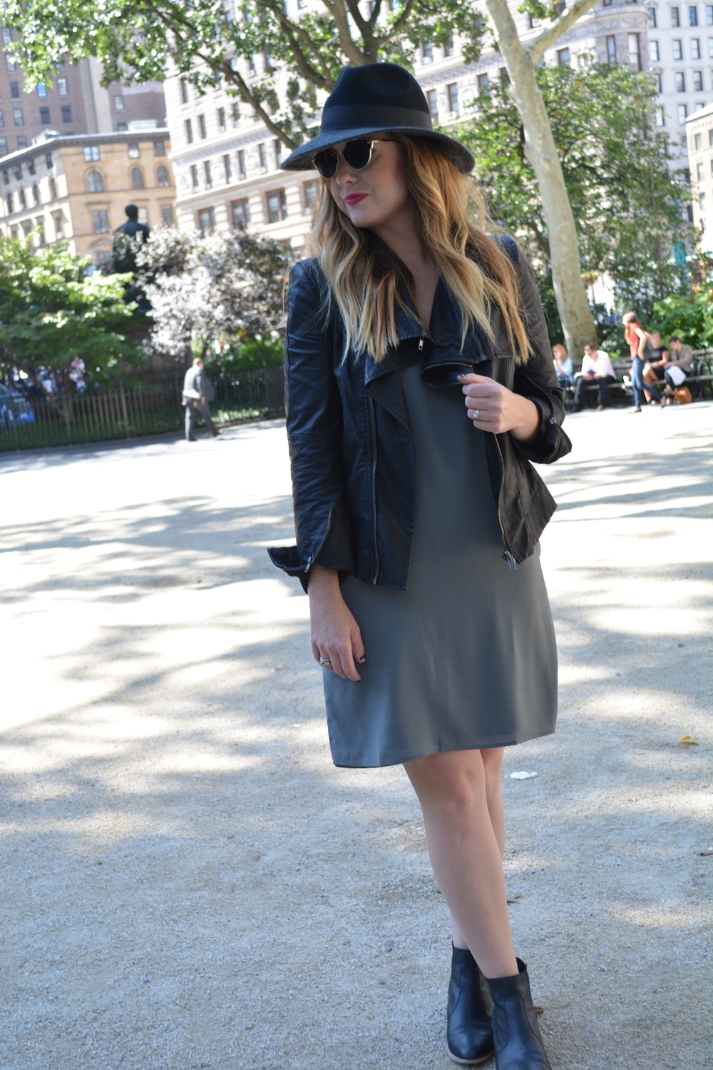 Wide brim hat, moto jacket with shift dress
