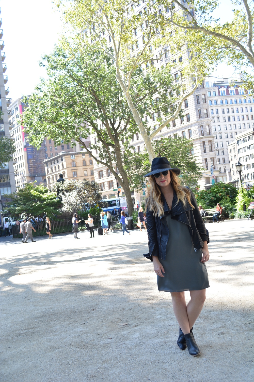 Wide brim hat, moto jacket, shift dress