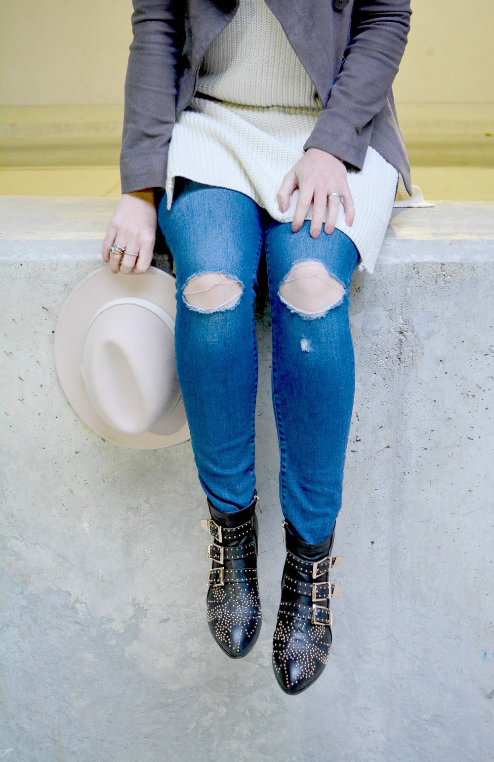 Distressed jeans with black booties