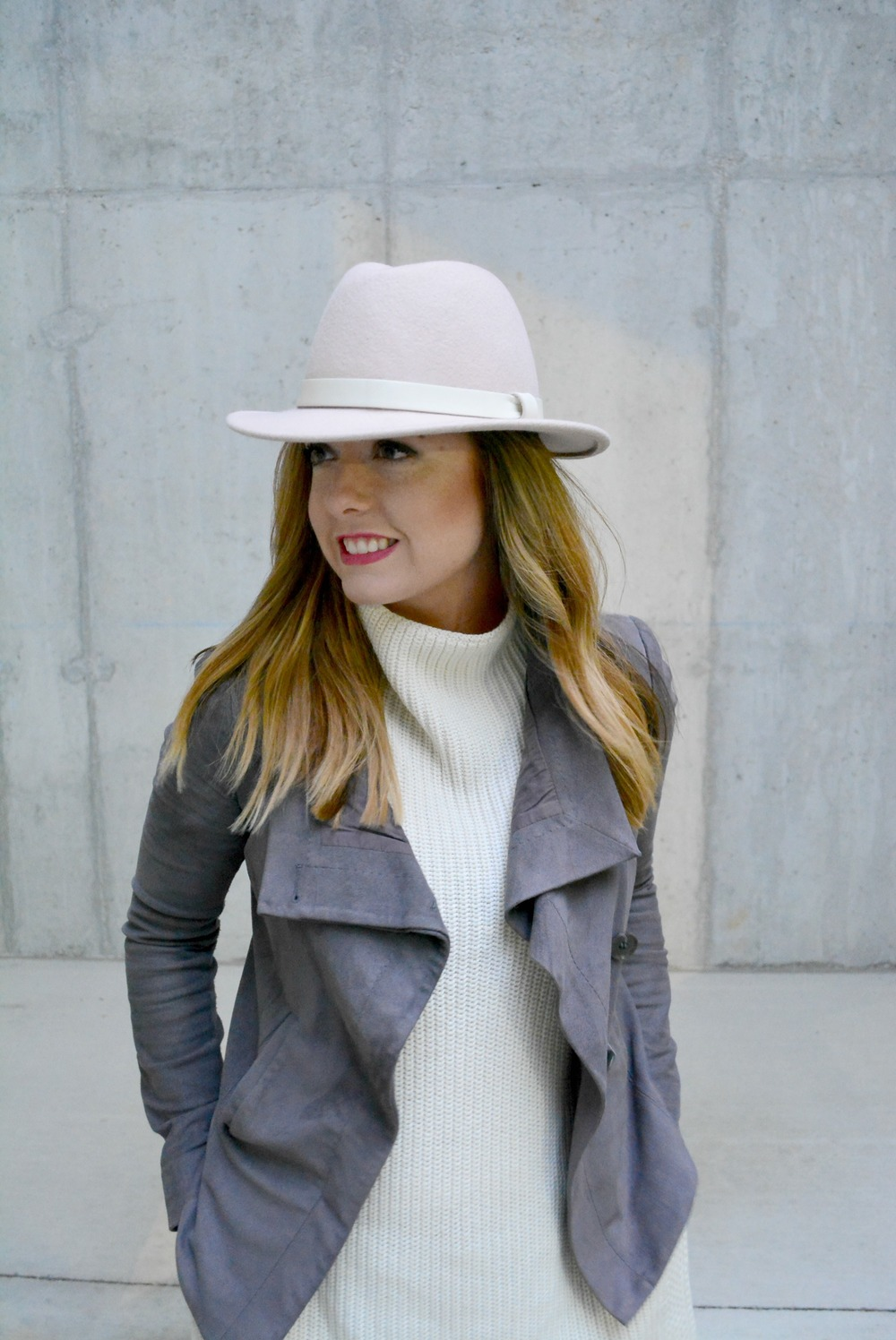 Soft pink hat with cream sweater with gray suede jacket for winter