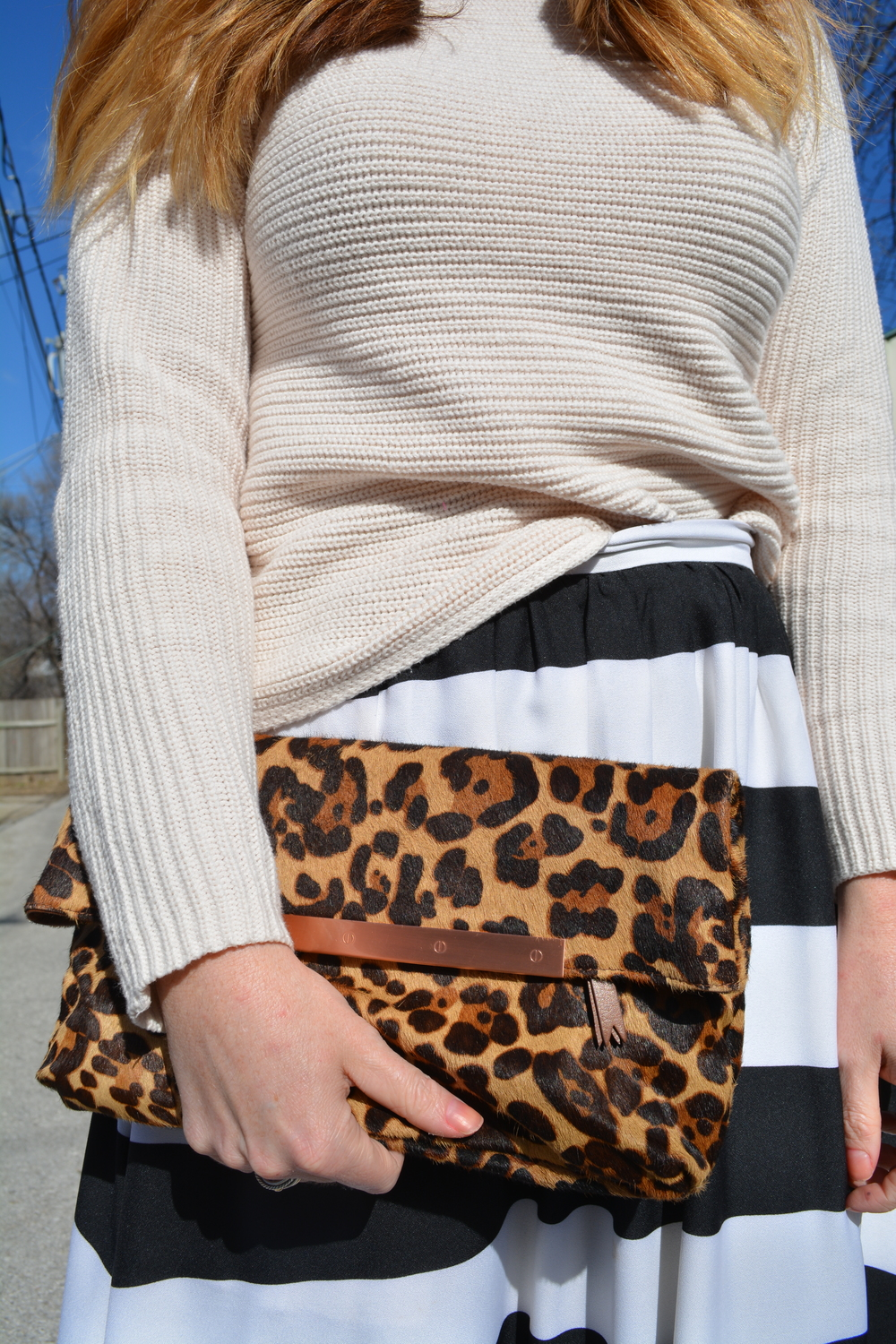 Blush sweater, leopard clutch and stripe skirt for VDAY