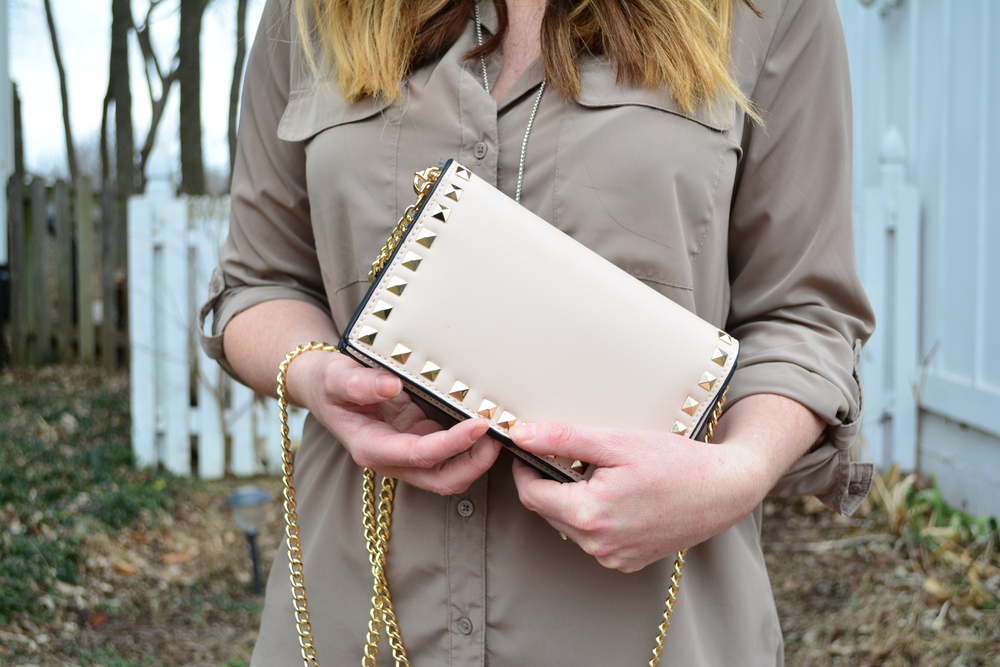 Blush studded clutch for spring