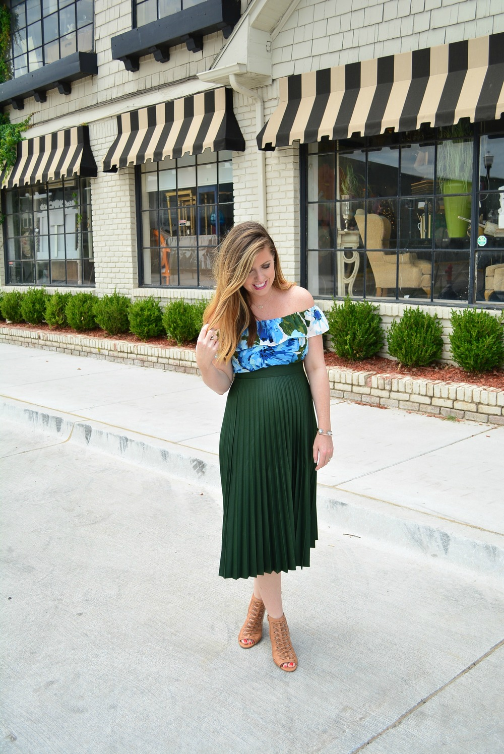 Floral off the shoulder top with accordion skirt for a sassy maternity look