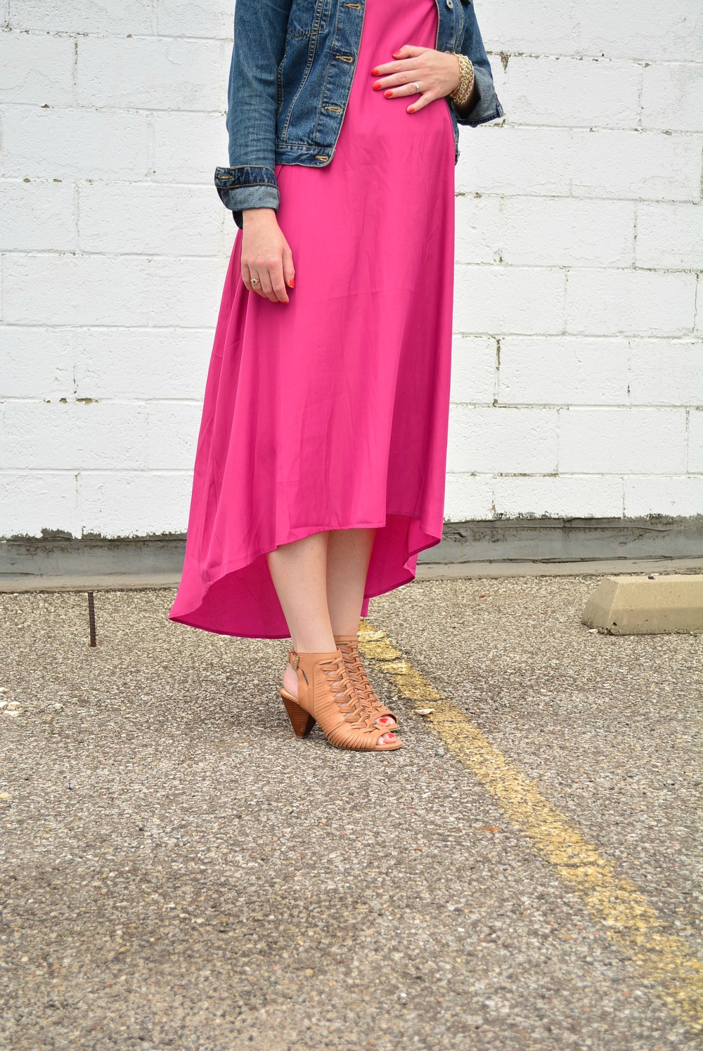 Maternity outfit of fuchsia maxi dress with denim jacket