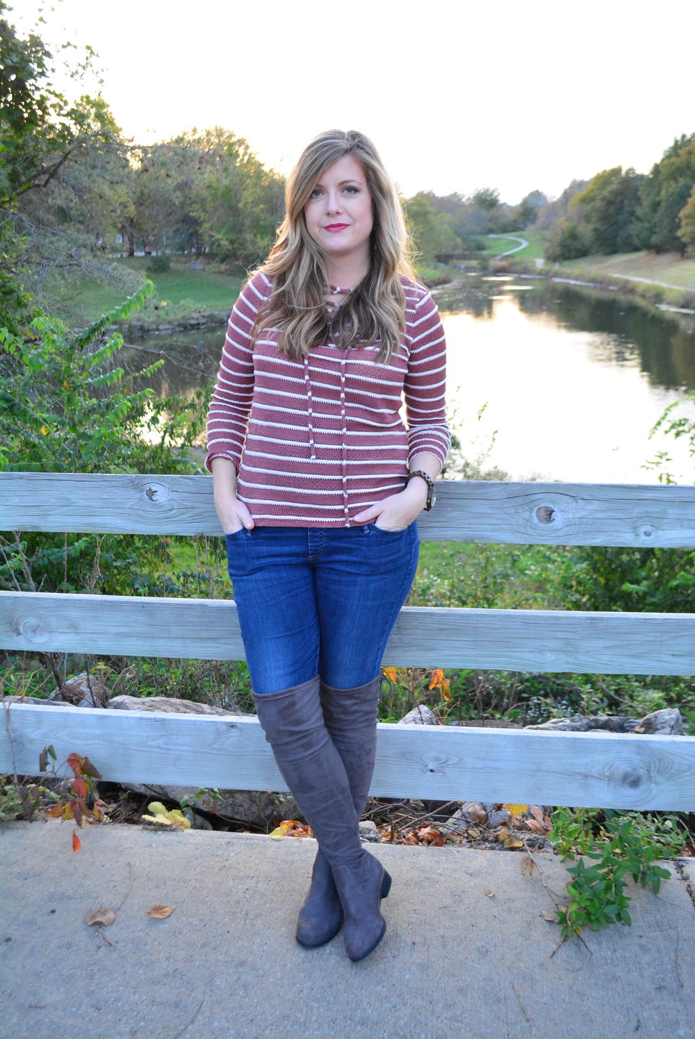 Striped lace up top and over the knee boots for a fall outfit