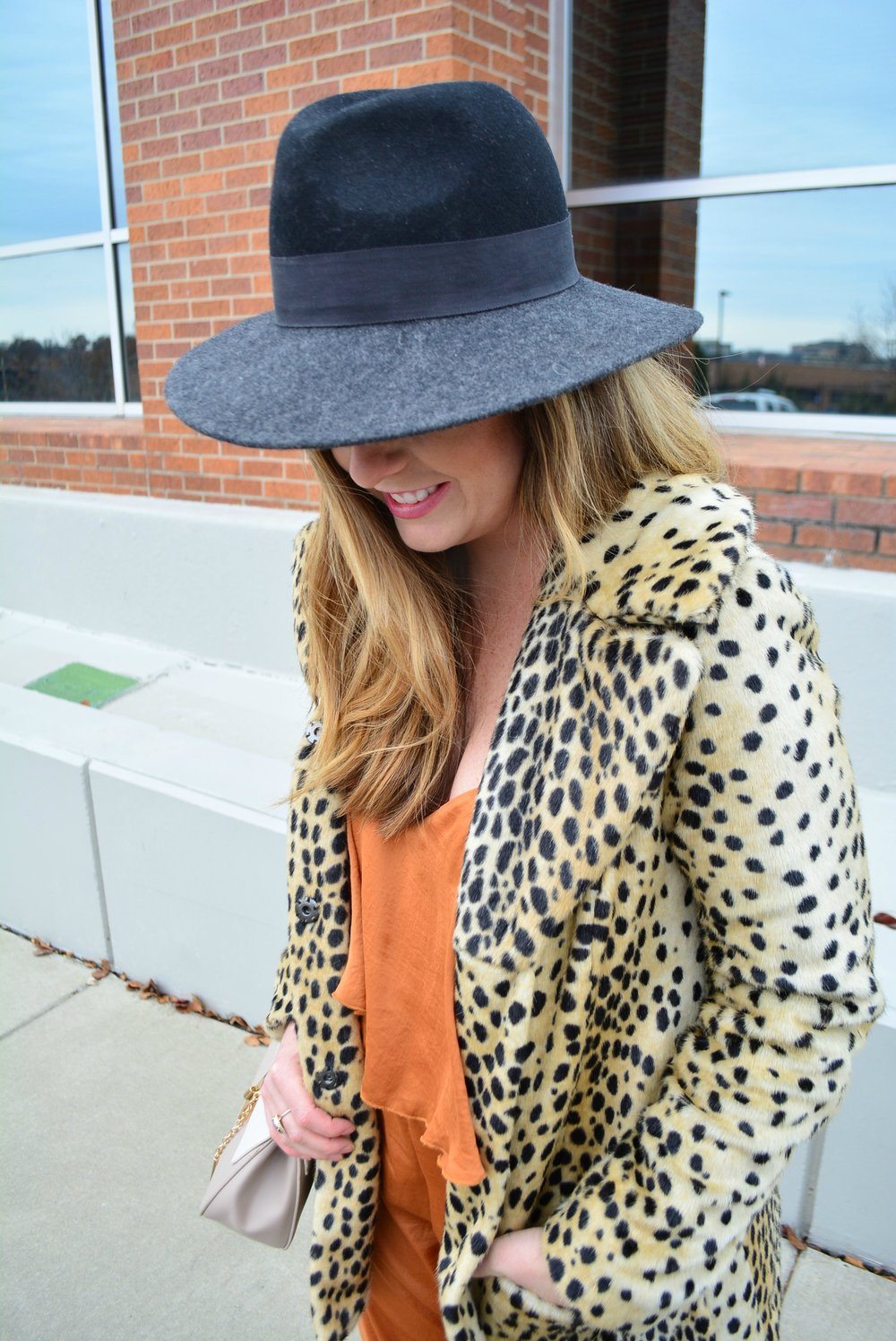Black fedora and leopard coat