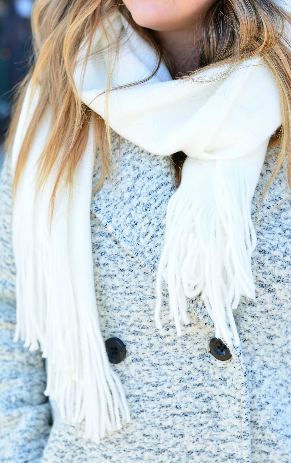 White scarf with gray coat