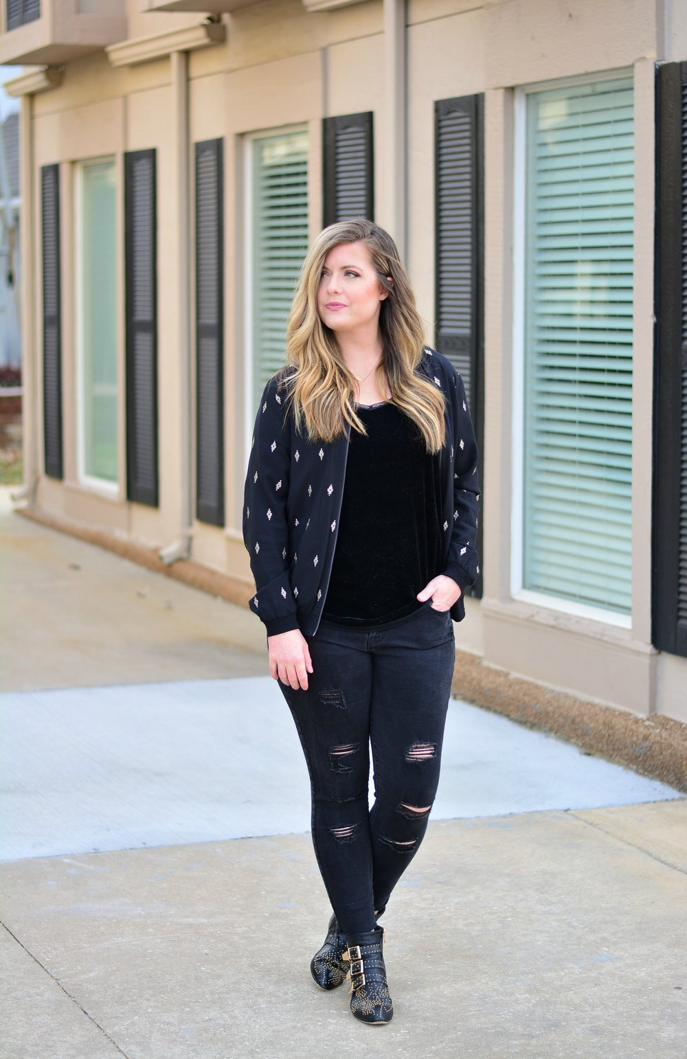 Black and gold bomber with velvet tank and distressed black jeans