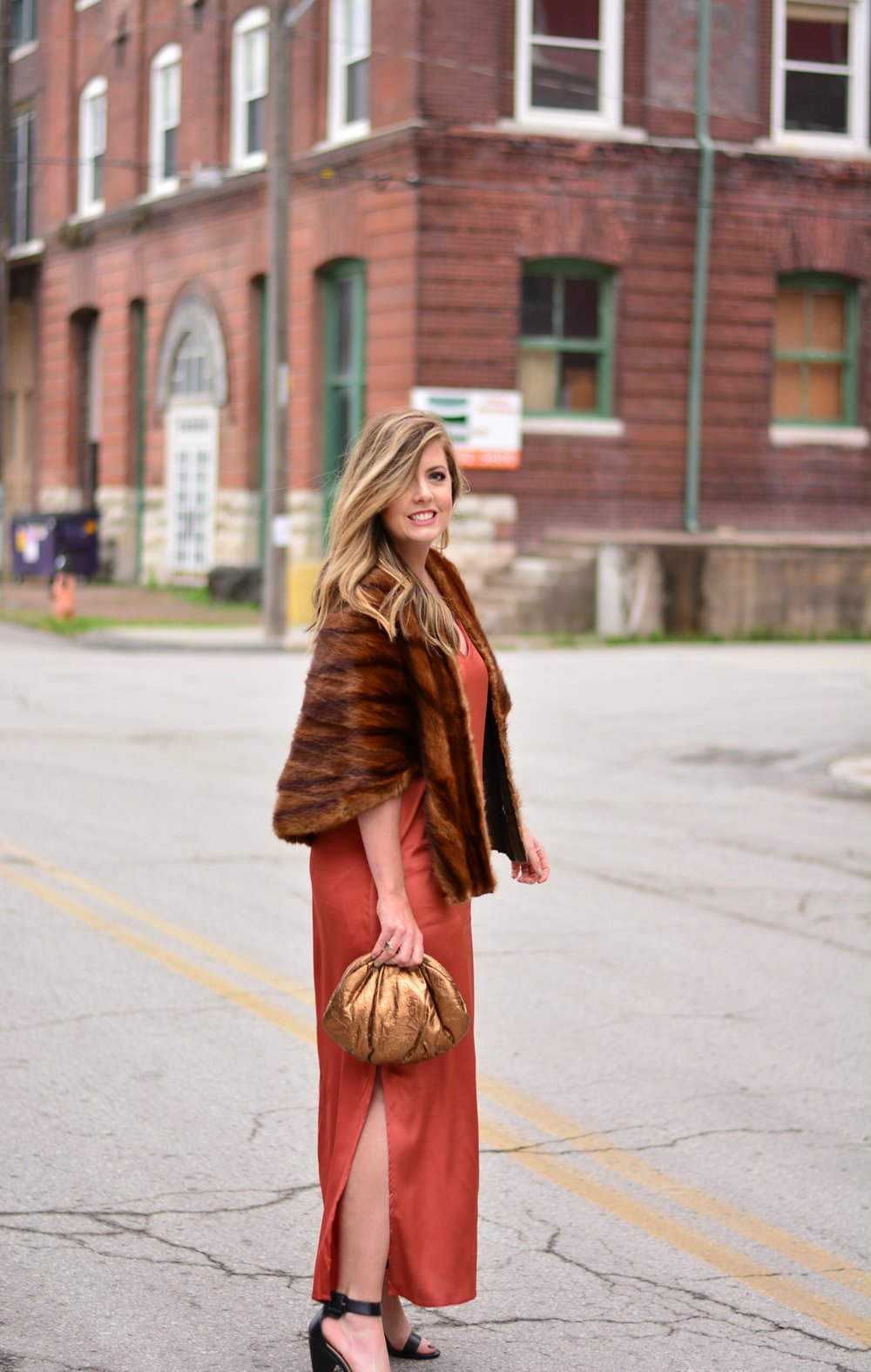Vintage fur with a rust dress for black tie