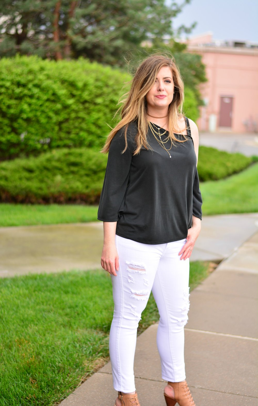One shoulder black top with white jeans