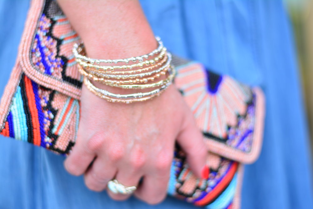 Stacked Kendra Scott bracelets