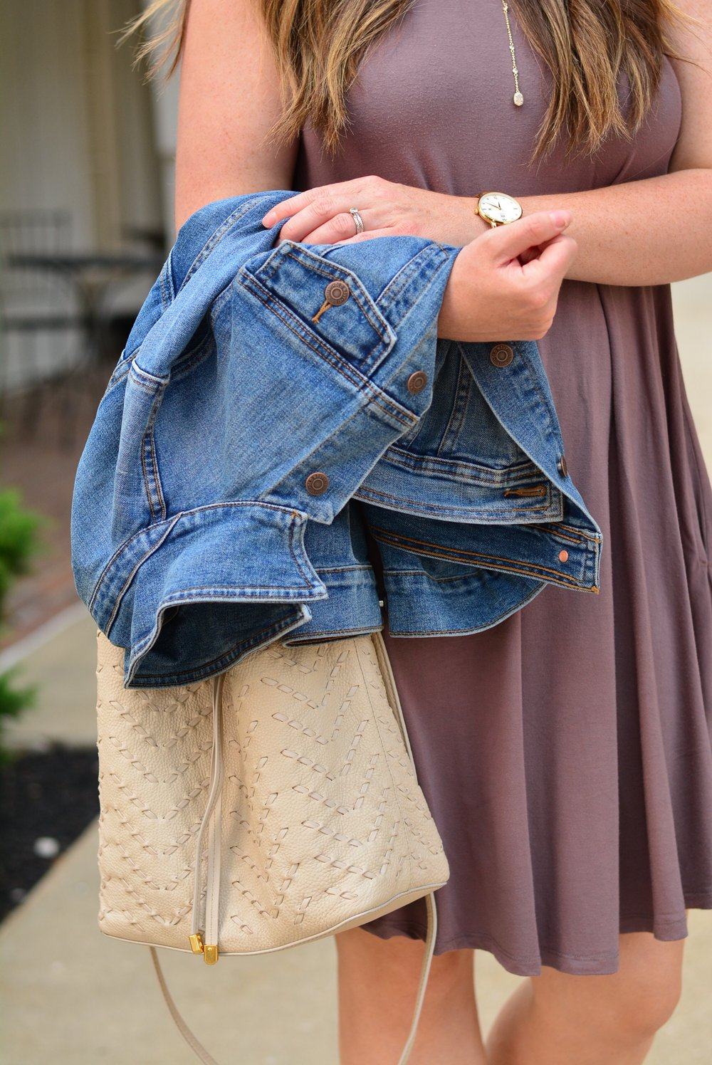 denim jacket with ivory bag