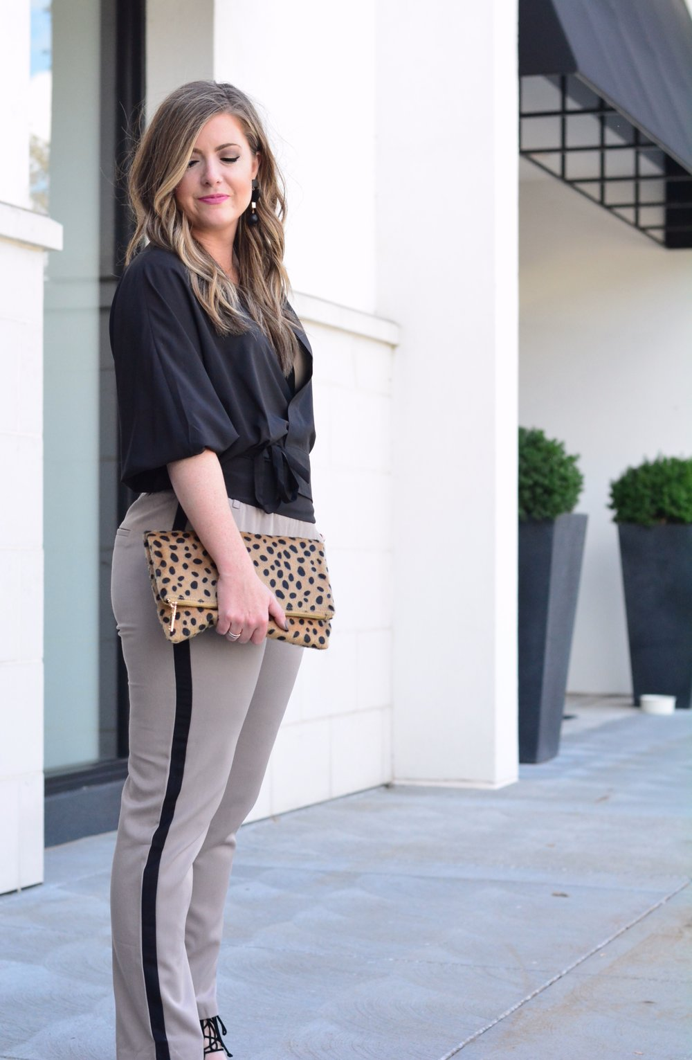 Black top and tuxedo pants