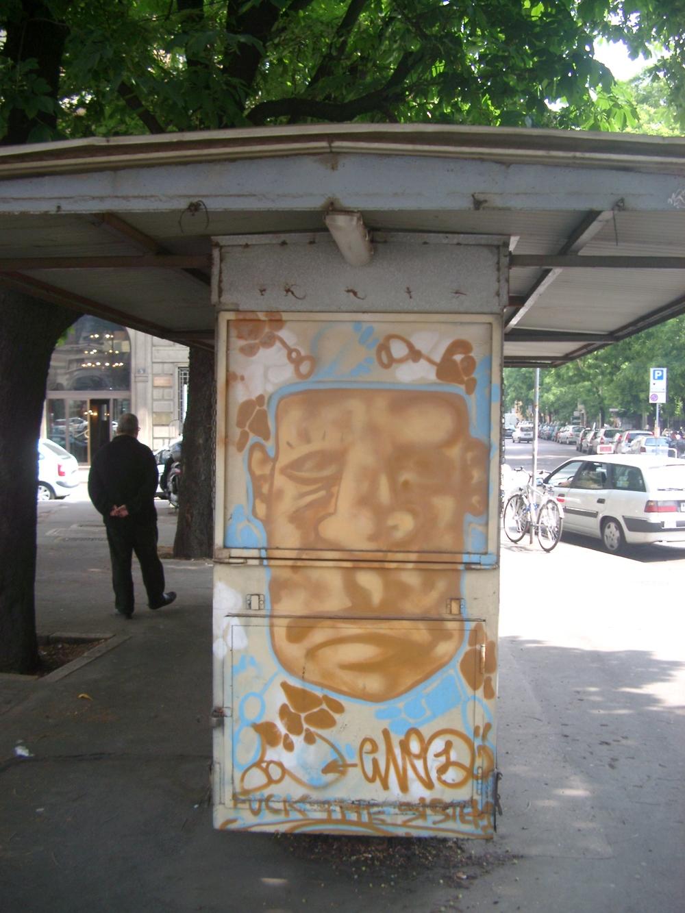 Newstand Face, Milan.JPG