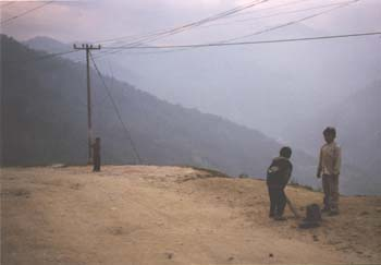 Boys playing cricket on a roadside in Sikkim. (JAMES FLINT)
