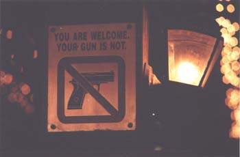 """No guns"" sign over entrance to restaurant in Manila. (JAMES FLINT)"