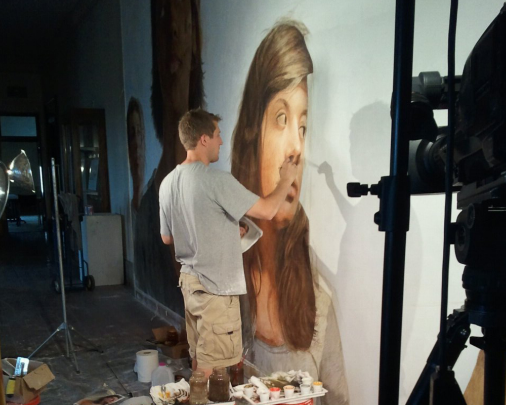 Michael Nichols painting the buon fresco at Van Meter Auditorium.  Photo by Cheryl Beckley, WKYU-PBS
