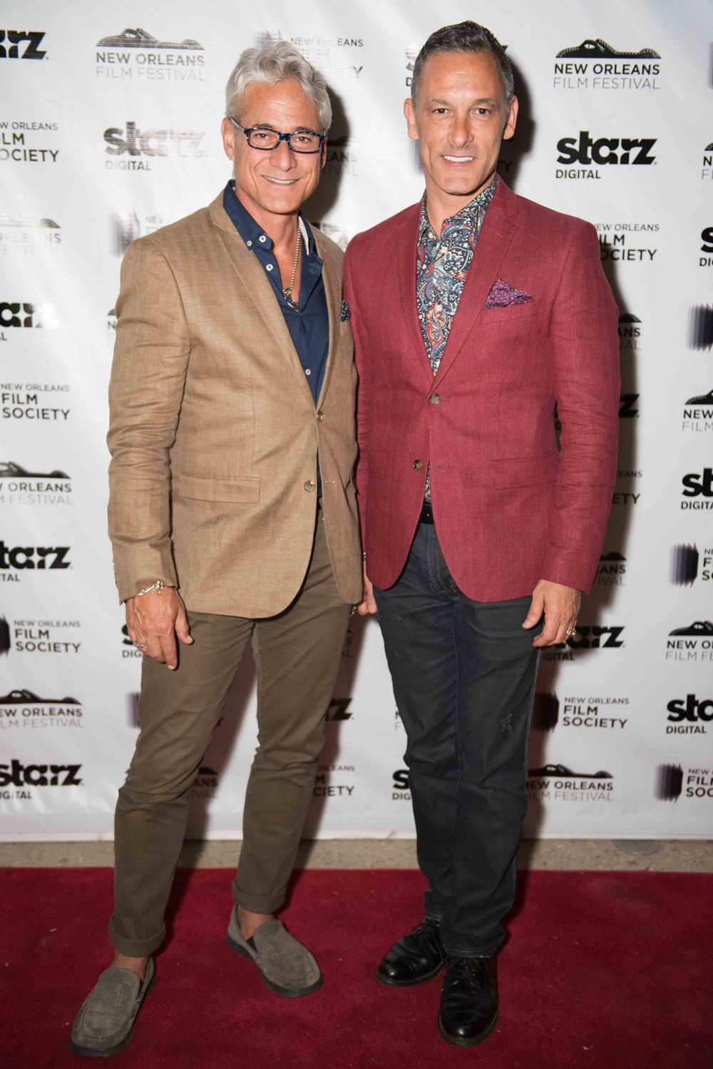 NEW ORLEANS, LA - October 24, 2014: (L-R) Greg Louganis and Husband Johnny Chaillot at the Premiere of Back on Board at the Prytania Theater during the 2014 New Orleans Film Fest in New Orleans, Louisiana (photo by Adrienne Battistella, 2014)