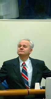 Defiant former Serbian President Slobodan Milosevic facing war crimes charges at The Hague. He died in 2006.
