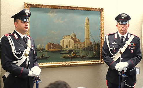 Carabinieri at the ready beside a recovered 18th-century Canaletto.