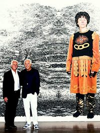 The Marciano brothers in front of a Cindy Sherman photo-mural.