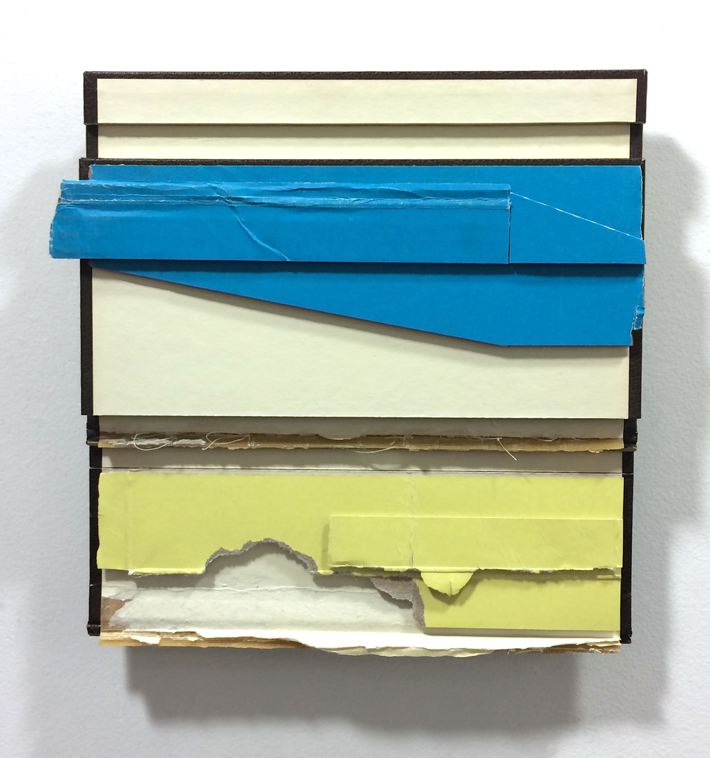 With  , 2015  found (unpainted) cardboard, cut book cover, foamcore  12 x 11.25 x 2 inches