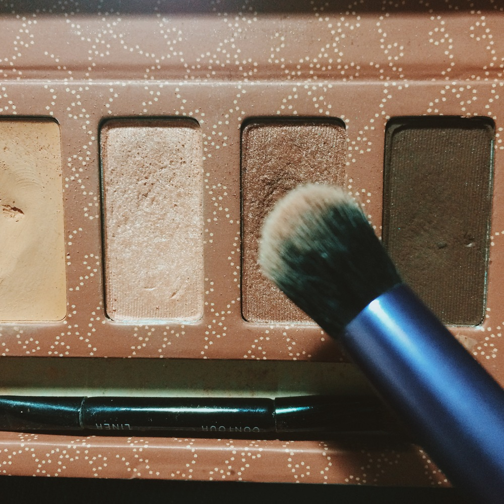 Using a crease brush, take the second color and pack that onto your crease. I do a half moon motion kind of swiping only concentrating on my crease.