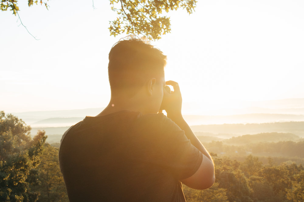 I took a photo of Jorge taking a photo of the glorious sunrise, on the morning we drove to Ohio.