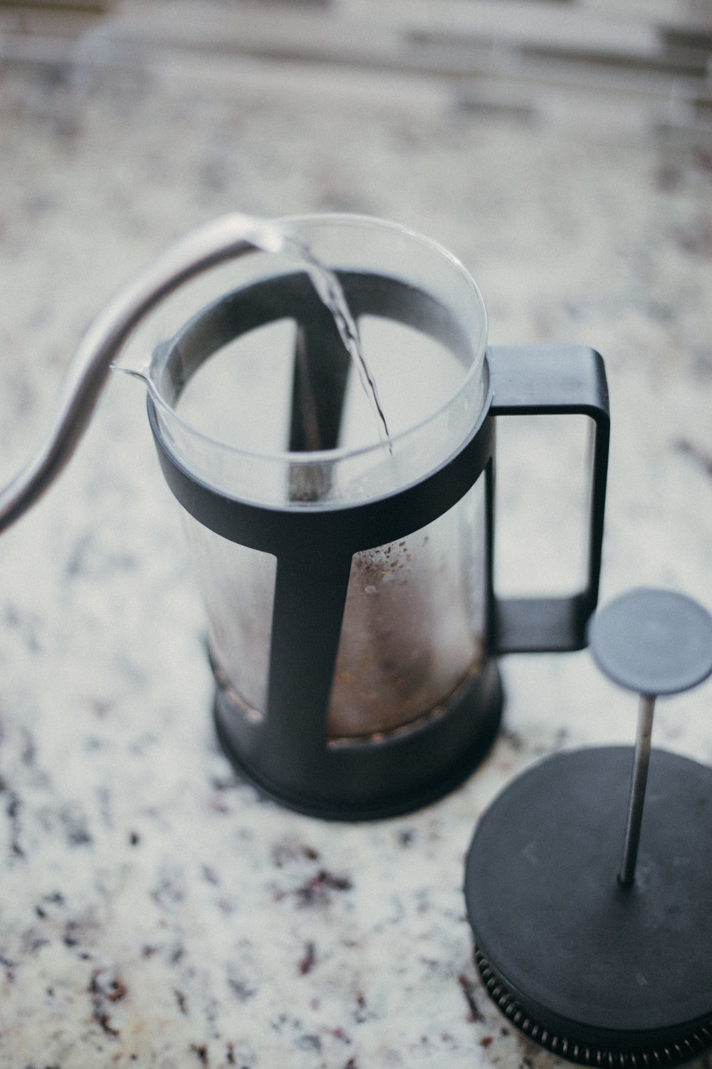 Pour boiling water in french press. Make sure to use coarse coffee grounds.