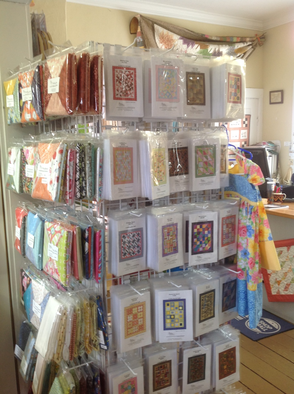 Display of Holly Bunches patterns and coordinating fat quarter packs.