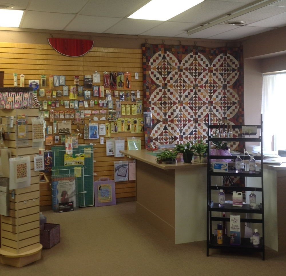 Front Counter and Notions wall at Huron River Quilts.  Note the beautiful quilt on display behind the counter!